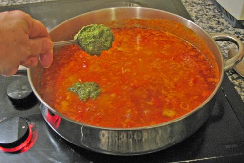 Adding pesto to the marinara sauce
