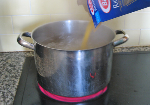 Photo of adding pasta to boiling water