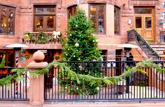 Christmas decorations along storefronts on Newbury Street in Boston's Back Bay neighborhood
