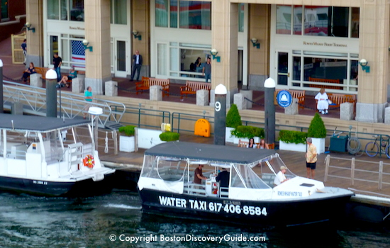 Water taxi in front of the Rowes Wharf Ferry Terminal / Ticket Office