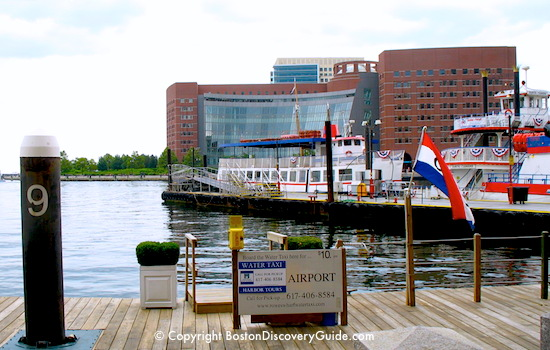Photo of sign for Boston water taxi near InterContinental Hotel Boston - looking across Ft Point Channel to Moakley Courthouse / Boston Water Taxi - www.boston-discovery-guide.com