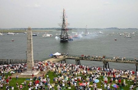 Photo of USS Constitution giving a 21-gun salute In Boston Harbor near Castle Island - www.boston-discovery-guide.com