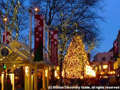Another photo of Faneuil Hall Marketplace at night, with holiday lights and decorations
